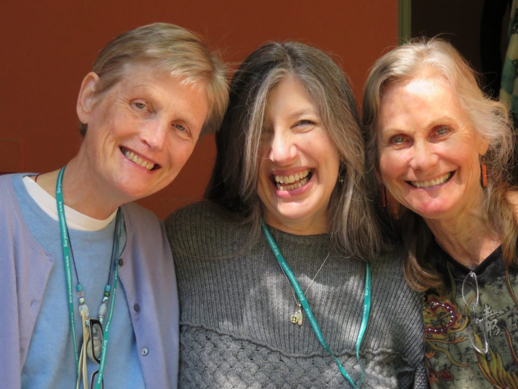 Three Commonweal Cancer Help Program alums standing together.